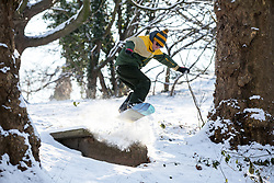© Licensed to London News Pictures. 28/02/2018. London, UK. Simon Bennett, 37, from Charlton snowboards in Greenwich Park following heavy snowfall and sub zero temperatures overnight. The cold weather originating in Siberia has been dubbed 'the Beast from the East'.  Photo credit : Tom Nicholson/LNP