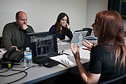 Students in Carlin Miller's University of Windsor Department of Psychology discuss a paper.