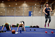"Staff Sgt. Ashleigh Buch, an instructor with the 338th Combat Training Squadron, right, jumps during her PT (physical training) at a ""boot camp"" workout class next to Stacey Thompson, left, and Hannah Van Gelder, center, on Wednesday, January 25, 2016 at Offutt Air Force Base in Nebraska."