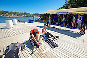 Divers prepare for action prior to a dive in Puerto Galera, the Philippines. There are more than 45 dive sites dotted around the small island, inclusing wrecks and a UNESCO protected site know to contain 60 percent of the world's marine life.