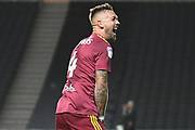 Ipswich Town defender Luke Chambers (4) celebrates with the Ipswich support during the EFL Sky Bet League 1 match between Milton Keynes Dons and Ipswich Town at stadium:mk, Milton Keynes, England on 17 September 2019.