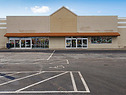 """26 FEBRUARY 2020 - FARMINGTON, MINNESOTA: The closed Family Fresh Market grocery store Farmington, MN, about 30 minutes south of the Twin Cities. Farmington, with a population of 21,000, is a farming community that has become a Twin Cities suburb, the population has doubled since the 2000 census. The Family Fresh Market, Farmington's only grocery store, closed in December, 2019. The closing turned the town into a """"food desert."""" The USDA defines food deserts as having at least 33% or 500 people of a census tract's population in an urban area living 1 mile from a large grocery store or supermarket. Grocery chains Hy-Vee and Aldi both own land in Farmington but they have not said when they plan to build or open stores in the town.      PHOTO BY JACK KURTZ"""