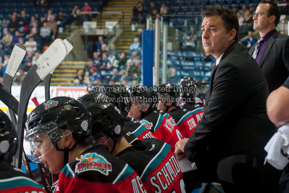 KELOWNA, CANADA - OCTOBER 7: Dan Lambert, head coach of the Kelowna Rockets stands on the bench opposite the Swift Current Broncos on October 7, 2014 at Prospera Place in Kelowna, British Columbia, Canada.  (Photo by Marissa Baecker/Getty Images)  *** Local Caption *** Dan Lambert;