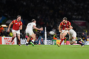Wales wing George North offloads one-handed during the Rugby World Cup Pool A match between England and Wales at Twickenham, Richmond, United Kingdom on 26 September 2015. Photo by David Charbit.
