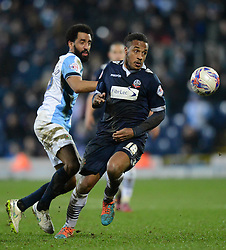 Bolton Wanderers' Neil Danns competes with Blackburn Rovers's Lee Williamson - Photo mandatory by-line: Richard Martin-Roberts/JMP - Mobile: 07966 386802 - 11/03/2015 - SPORT - Football - Blackburn - Ewood Park - Blackburn Rovers v Bolton Wanderers - Sky Bet Championship