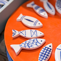 Blue and white ceramic fish at Colette Ripley's ceramic workshop and boutique located in the Panier neighborhood of Marseille, France.