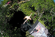 Sinkhole cliff diving competition held in Mexico<br /> <br /> Daredevil athletes have jumped from the edge of a 90ft deep sinkhole in a remote part of Mexico, as part of a cliff diving contest.<br /> Divers in the 'Cliff Diving World Series' performed stunts and reached speeds of 40mph before hitting the dark water of Cenote Ik Kil.<br /> Gary Hunt, from Southampton was the overall winner and managed to pull off a Triple Quad – one of the most difficult dives in the world.<br /> The Red Bull event lasted for two days -- though most of that time was probably taken up trying to get back out after each jump. <br /> Gary scored 373.85 and edged out second-placed Silchenko by a little over 10 points, with 2009 champion Duque taking third place.<br /> <br /> Photo Shows: Cyril Oumedjkane of France dives from the 27.2 metre platform during round two of the 2010 Red Bull Cliff Diving World Series, Cenote Ik Kil, Yucatan, Mexico on June 05; 2010. <br /> (©Ray Demski/Exclusivepix)