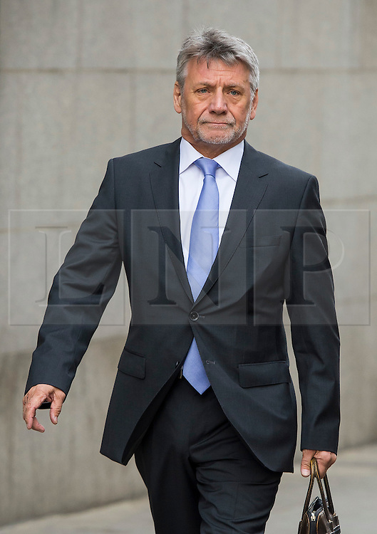 © Licensed to London News Pictures. 08/06/2015. London, UK. Former News of the World deputy editor NEIL WALLIS arriving at The Old Bailey in London where he is charged with intercepting voicemails while working for the newspaper between January 2003 and January 2007. Photo credit: Ben Cawthra/LNP