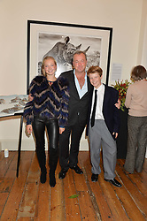 DAVID YARROW and his children JADE YARROW & CAMERON YARROW at a private view of photographs by renowned wildlife photographer David Yarrow in aid of TUSK entitled 'Wild Encounters' held at Somerset House on 19th September 2016.