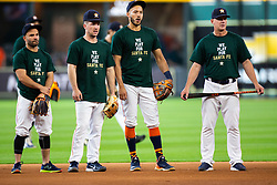 May 22, 2018 - Houston, TX, U.S. - HOUSTON, TX - MAY 22: Houston Astros second baseman Jose Altuve (27), Alex Bregman (2), Carlos Correa (1), manager AJ Hinch (14) and teammates wearing a shirt remembering the students and teachers killed at Santa Fe High School as the team takes batting practice prior to an MLB baseball game between the Houston Astros and the San Francisco Giants on May 22, 2018 at Minute Maid Park in Houston, Texas. (Photo by Juan DeLeon/Icon Sportswire) (Credit Image: © Juan Deleon/Icon SMI via ZUMA Press)