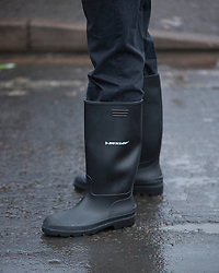 Ed Miliband wearing  wellington boots when he visited  floods in Purley on Thames, Reading, United Kingdom,Tuesday, 11th February 2014. Picture by i-Images