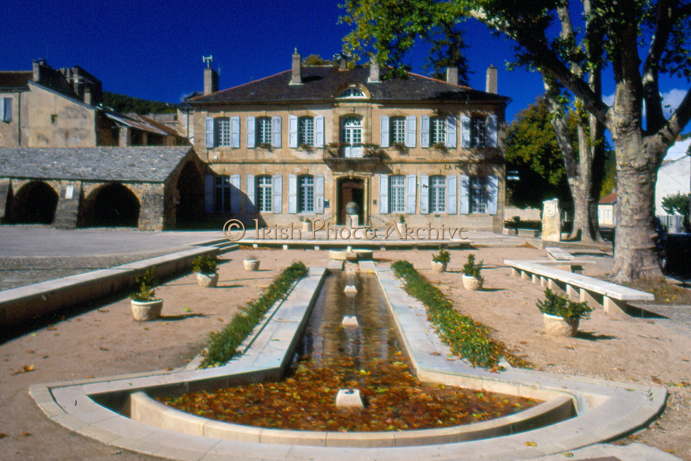 France, Languedoc and Roussillon.  Nant.  Town square and post office.