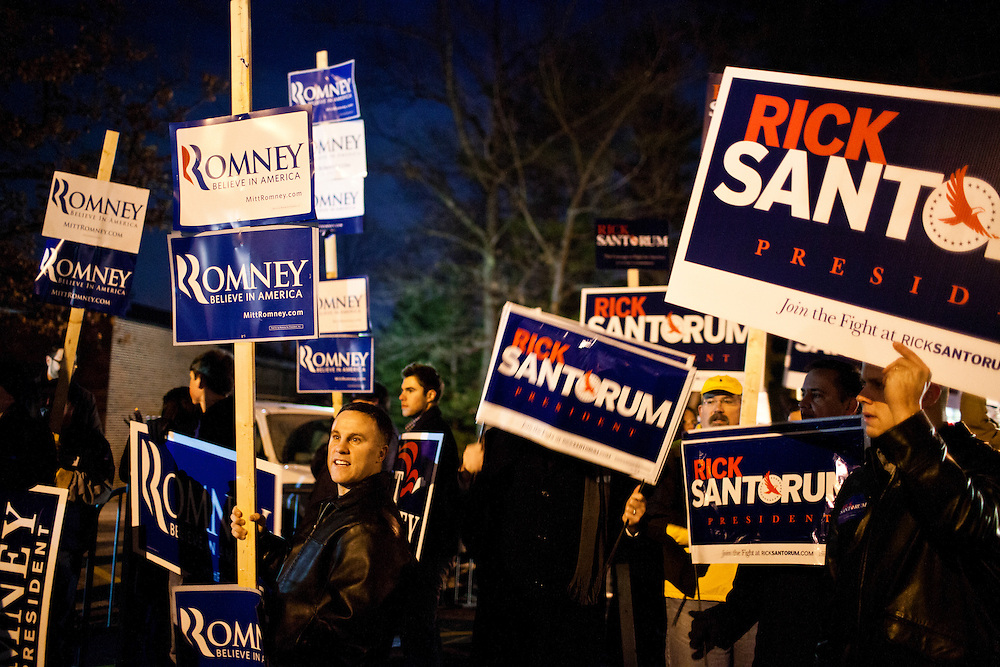 Supporters of Republican presidential candidates Mitt Romney and Rick Santorum rally outside the site of the WMUR/ABC News Debate at Saint Anselm College on Saturday, January 7, 2012 in Manchester, NH. Brendan Hoffman for the New York Times