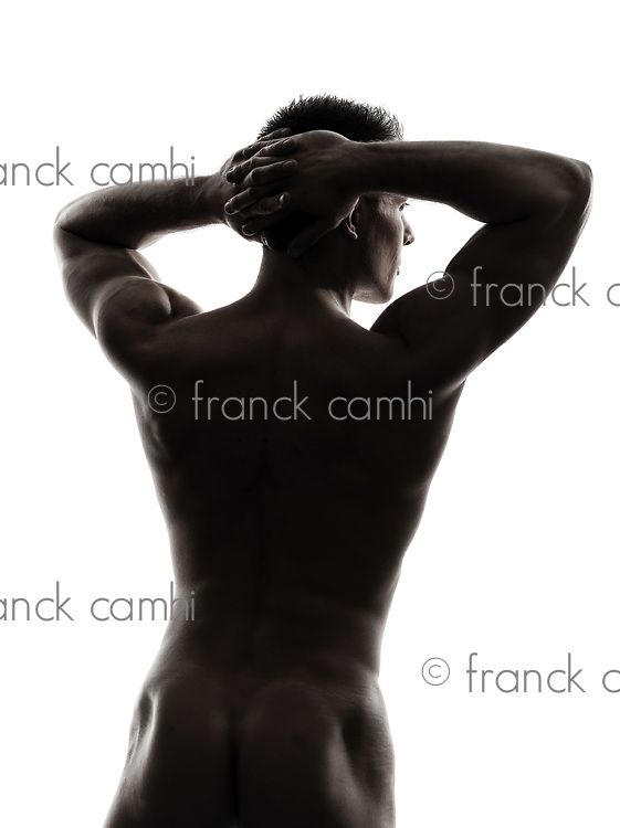 one  handsome naked muscular man rear view back in silhouette studio on white background