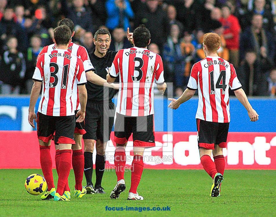 Picture by Richard Gould/Focus Images Ltd +44 7855 403186<br /> 02/11/2013<br /> Ref Andre Marriner tells Andrea Dossena (3) of Sunderland to leave the field after been sent off during the Barclays Premier League match at the KC Stadium, Kingston upon Hull.