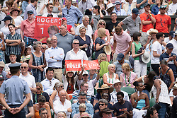 © Licensed to London News Pictures. 04/07/2018. London, UK. Fans of Roger Federer watch him play Lukas Lacko of Slovakiain the mens 2nd round singles draw of the Wimbledon Tennis Championships 2018, Day 3. Photo credit: Ray Tang/LNP
