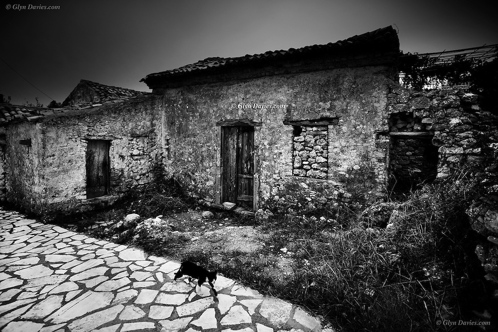 On the top of a high headland, in an apparently deserted village on the mountainous West Coast of Corfu, a cat silently and purposefully walks down a mosaic lane, it glanced at us in acknowledgement, but we didn't speak Greek so it moved into the shadows.