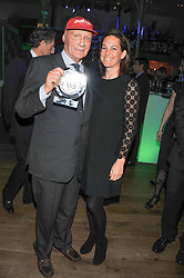 NIKI LAUDA and his wife BIRGIT LAUDA at the Motor Sport magazine's 2013 Hall of Fame awards at The Royal Opera House, London on 25th February 2013.