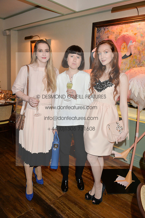 Left to right, DAISY DE VILLENEUVE, ROSE BLAKE and actress OLIVIA GRANT at a dinner hosted by Kate Spade NY to celebrate Chelsea in Bloom held at Daphne's, 112 Draycott Avenue, London on 20th May 2015.