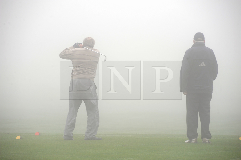 © Licensed to London News Pictures. 24/09/2013<br /> Foggy morning for golf in the South East.<br /> Fog across the south east this morning as Golfers at Orpington Golf Centre,Sandy Lane, Orpington continue to play as normal.<br /> Photo credit :Grant Falvey/LNP