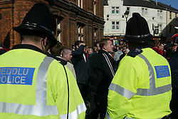 CARDIFF, WALES - Sunday, March 2, 2003: Welsh police keep a watchful eye on Liverpool and Manchester United fans before the Football League Cup Final at the Millennium Stadium. (Pic by David Rawcliffe/Propaganda)