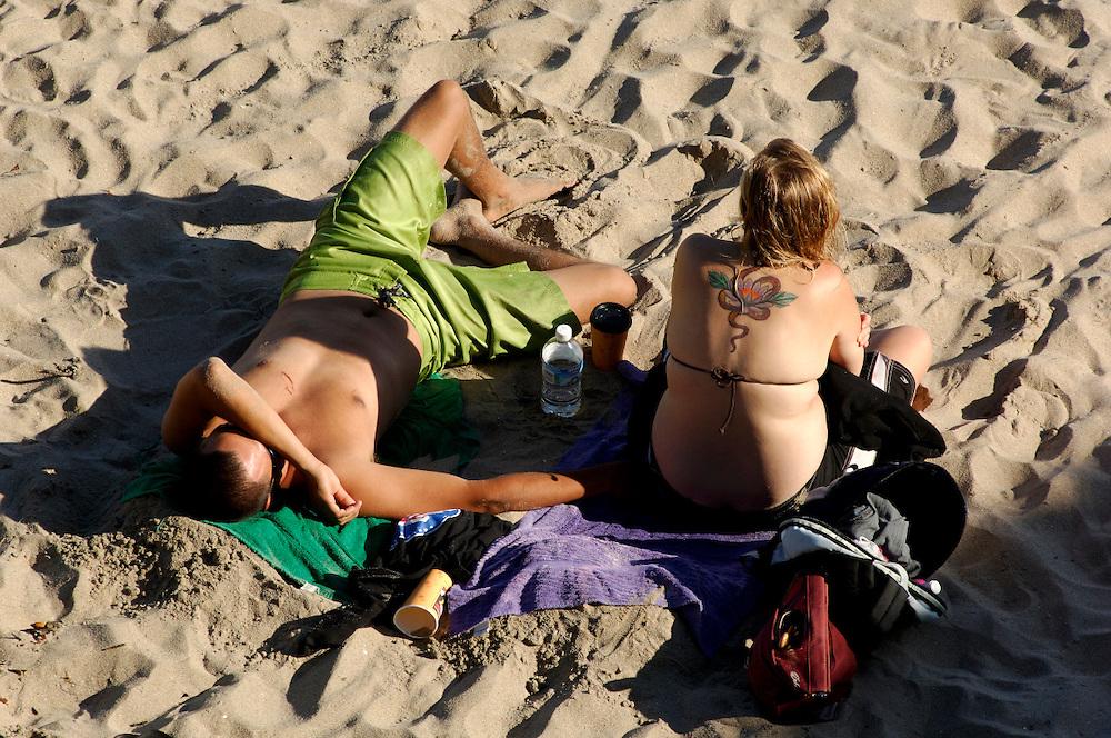Sunbathing on Sandy Beach, Santa Cruz, California, United States of America