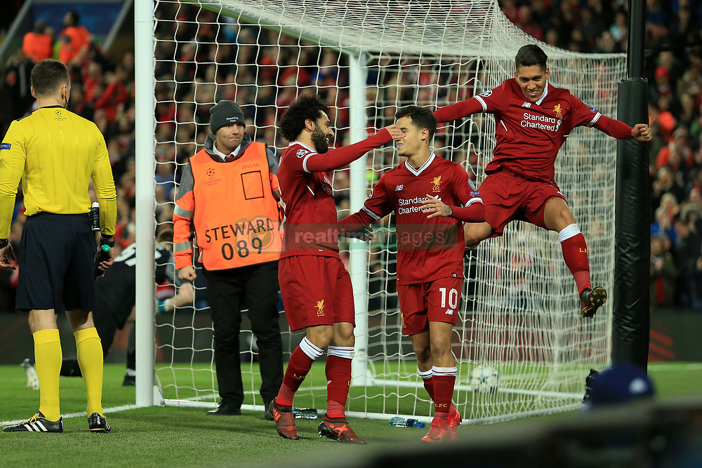 6th December 2017 - UEFA Champions League - Group E - Liverpool v Spartak Moscow - Philippe Coutinho of Liverpool (C) celebrates with teammates Mohamed Salah (L) and Roberto Firmino (R) after scoring their 5th goal - Photo: Simon Stacpoole / Offside.