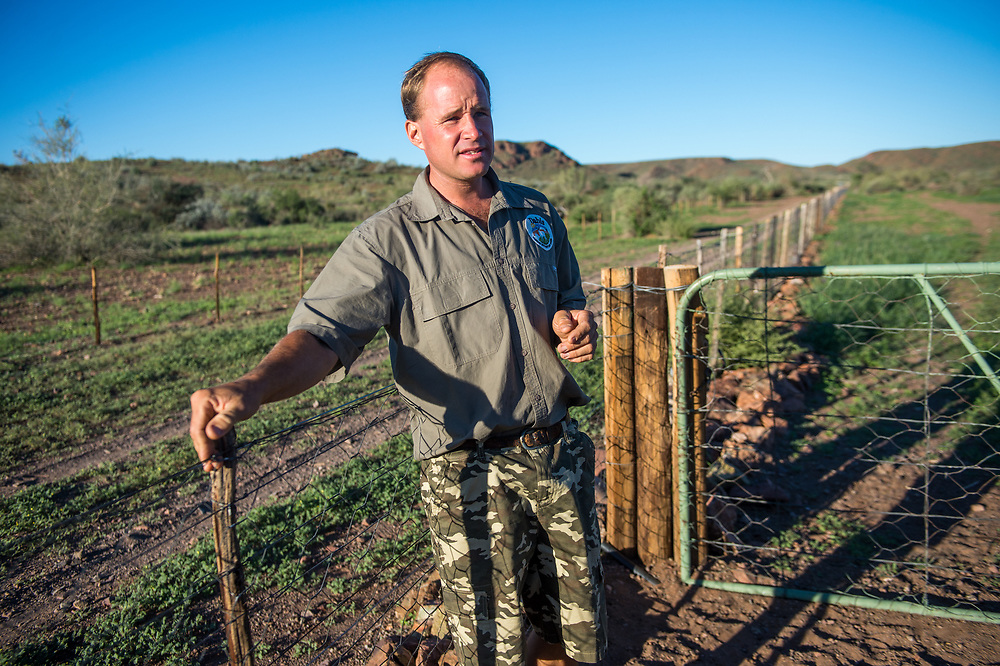 Farmer shows off fencing system in Helmeringhausen, southern Namibia, Africa.