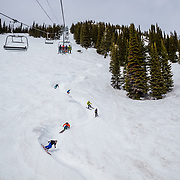 Forrest Jillson, Jim Ryan, Macky Young, Andrew Whiteford, Jeff Leger, and Keely Kelleher train the Teton Lift wiggle before closing day at Jackson Hole Mountain Resort.