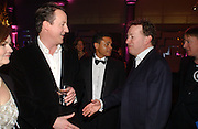 David Cameron and Orlando Fraser. The Black and White Winter Ball. Old Billingsgate. London. 8 February 2006. -DO NOT ARCHIVE-© Copyright Photograph by Dafydd Jones 66 Stockwell Park Rd. London SW9 0DA Tel 020 7733 0108 www.dafjones.com