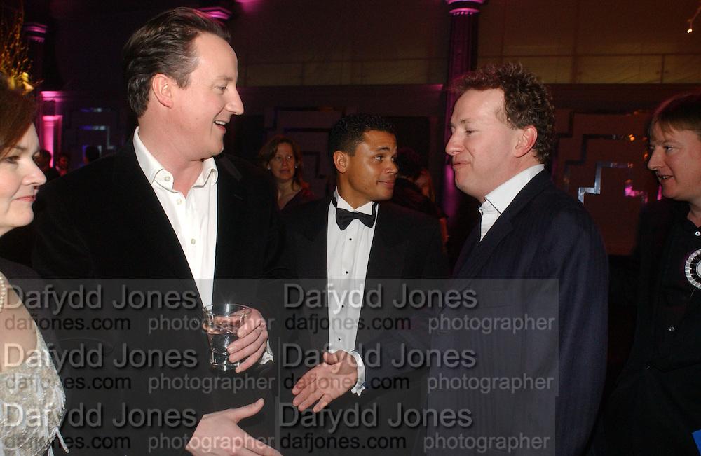 David Cameron and Orlando Fraser. The Black and White Winter Ball. Old Billingsgate. London. 8 February 2006. -DO NOT ARCHIVE-© Copyright Photograph by Dafydd Jones 66 Stockwell Park Rd. London SW9 0DA Tel 020 7733 0108 www.dafjones.com
