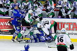 Matej Hocevar (HDD Tilia Olimpija, #14) and Damjan Dervaric (HDD Tilia Olimpija, #23) crashed with Medvescak players during ice-hockey match between KHL Medvescak Zagreb and HDD Tilia Olimpija in 42nd Round of EBEL league, on Januar 25, 2011 at Arena Zagreb, Zagreb, Croatia. (Photo By Matic Klansek Velej / Sportida.com)