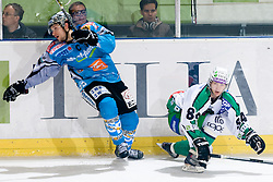 Andrej Hebar (HDD Tilia Olimpija, #84) vs Phillip Lukas (EHC Liwest Black Wings Linz, #21) during ice-hockey match between HDD Tilia Olimpija and EHC Liwest Black Wings Linz in 19th Round of EBEL league, on November 7, 2010 at Hala Tivoli, Ljubljana, Slovenia. (Photo By Matic Klansek Velej / Sportida.com)