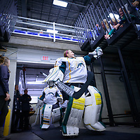 2nd year goalie Jane Kish (31) of the Regina Cougars enters the rink during the Women's Hockey home game on October 8 at Co-operators arena. Credit: Arthur Ward/Arthur Images