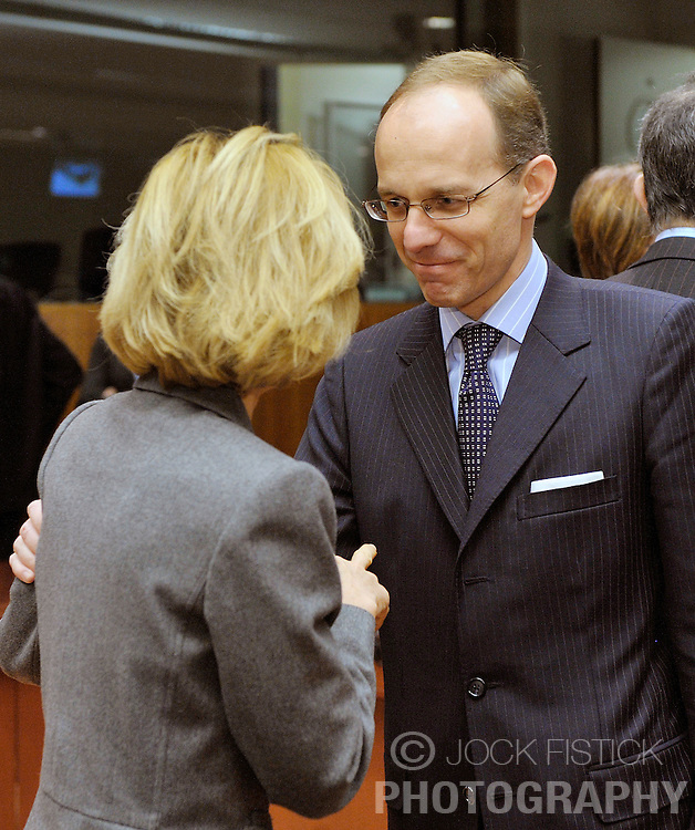 Luc Frieden, Luxembourg's finance minister, right, speaks with Elena Salgado, Spain's finance minister, during the meeting of European Union finance ministers  at the EU Council headquarters on Tuesday, Jan. 19, 2010, in Brussels, Belgium. (Photo © Jock Fistick)