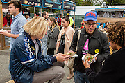 Queens, NY - October 2, 2016. Max Harwood (L) and Danny Miller of the band Lewis del Mar at The Feastival of Queens at The Meadows festival at Citi Field. In the center is Joe DiStefano, organizer of the Feastival of Queens..