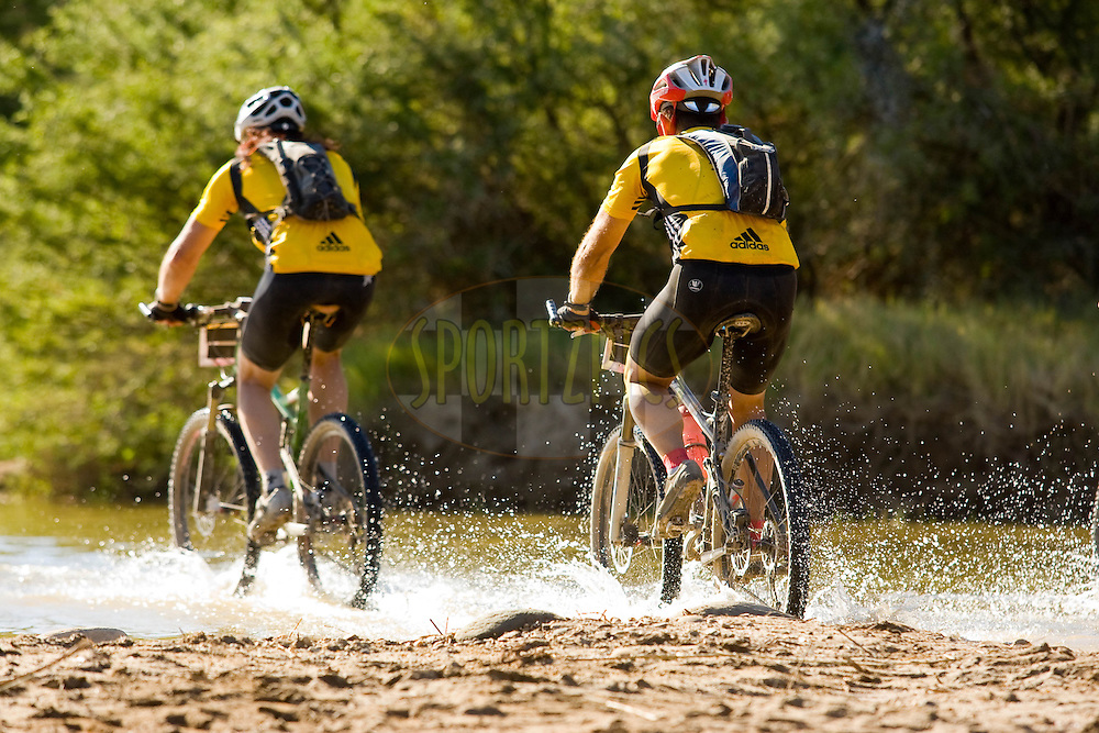 WESTERN CAPE, SOUTH AFRICA -  31 March 2008, crossing the grootrivier during stage three of the 2008 Absa Cape Epic Mountain Bike stage race from Calitzdorp Spa.to Langenhoven High School in Riversdale, Western Cape, South Africa..Photo by Sven Martin/SPORTZPICS
