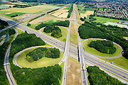 Nederland, Gelderland, Gemeente Lingewaard, 26-06-2013; knooppunt Ressen, gemeente Lingewaard.  A15 (Rozenburg-Ressen) en de A325 (Arnhem-Nijmegen). Betuweroute links in beeld.<br /> Motorway junction in the East of the Netherlands connection Port of  Rotterdam with German hinterland.<br /> luchtfoto (toeslag op standaard tarieven);<br /> aerial photo (additional fee required);<br /> copyright foto/photo Siebe Swart.