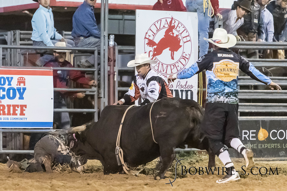 Bullfighters Cade Burns (dark shirt) and Nate Jestes rescue bull rider Jeston Mead from Summit Pro Rodeo's Body N Soul in the second performance of the Elizabeth Stampede on Saturday, June 2, 2018.
