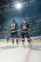 KELOWNA, CANADA - OCTOBER 18:  MacKenzie Johnston #22 and Cole Martin #8 of the Kelowna Rockets take part in a pre-game ritual on the ice as the Prince George Cougars visit the Kelowna Rockets on October 18, 2012 at Prospera Place in Kelowna, British Columbia, Canada (Photo by Marissa Baecker/Shoot the Breeze) *** Local Caption ***