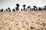 After leaving Libya, thousand of Bengladesh migrant workers trek to an UNHCR transit camp set up in Choucha, 7 km from Tunisia's Ras Jedir border station.<br /> 04 March 2011.