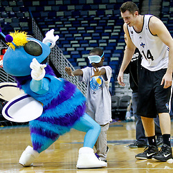 December 17, 2011; New Orleans, LA, USA; A blind-folded young New Orleans Hornets fan participates in a find Hugo game with forward Jason Smith (14) during a scrimmage at the New Orleans Arena.   Mandatory Credit: Derick E. Hingle-US PRESSWIRE