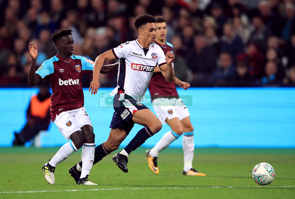 Bolton Wanderers' Antonee Robinson centre battle for the ball with West Ham United's Domingos Quina, left
