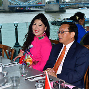 """Honourable 卢海田 参赞 the counsellor Lu Hai Tian from the Chinese embassy in London attends The celebration of the 70th China National Day 2019 and a Chinese """"Qipao"""" flash mob, London, 28 September 2019, UK."""