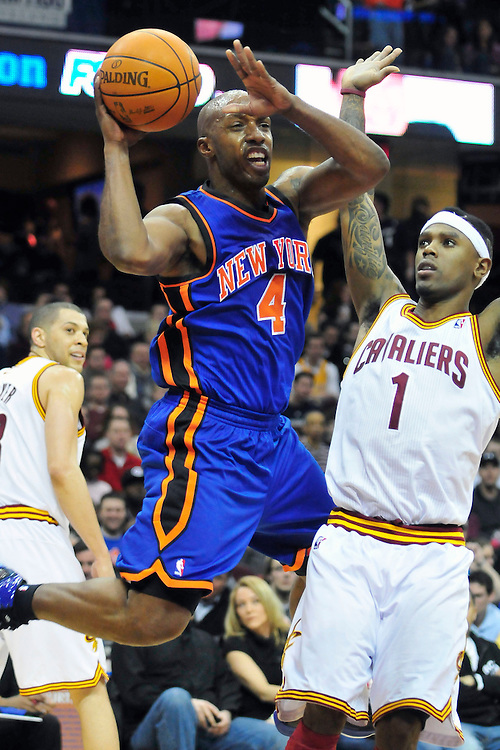 Feb. 25, 2011; Cleveland, OH, USA; New York Knicks point guard Chauncey Billups (4) makes a pass under pressure from Cleveland Cavaliers point guard Daniel Gibson (1) during the fourth quarter at Quicken Loans Arena. The Cavaliers beat the Knicks 115-109. Mandatory Credit: Jason Miller-US PRESSWIRE