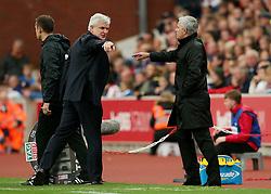 Stoke City manager Mark Hughes ushers Manchester United manager Jose Mourinho back into his technical area  - Mandatory by-line: Matt McNulty/JMP - 09/09/2017 - FOOTBALL - Bet365 Stadium - Stoke-on-Trent, England - Stoke City v Manchester United - Premier League