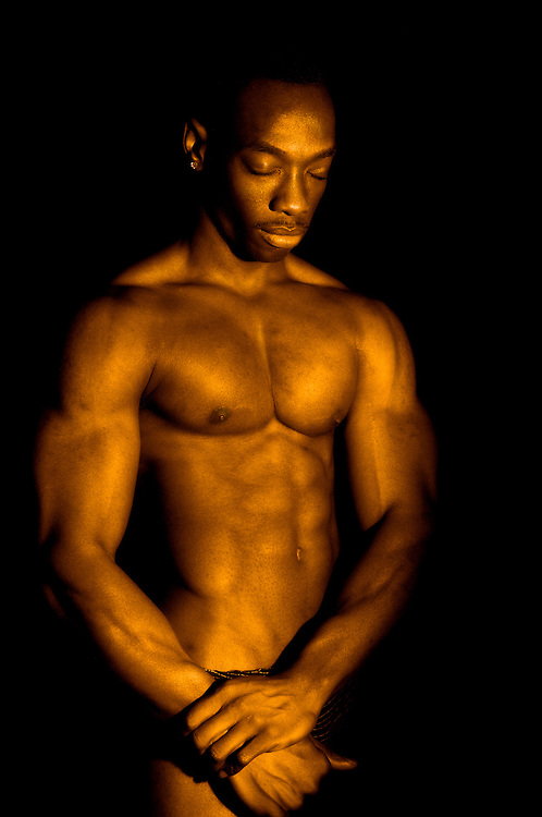 Comceptual image of bodybuilder in gold or golden bath.