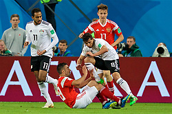 SAINT PETERSBURG, RUSSIA - Tuesday, June 19, 2018: Russia's Iury Gazinsky and Egypt's Tarek Hamed during the FIFA World Cup Russia 2018 Group A match between Russia and Egypt at the Saint Petersburg Stadium. (Pic by David Rawcliffe/Propaganda)