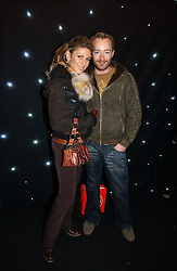 Fashion designer SCOTT HENSHALL and HOFIT GOLAN at the launch of he LG 'Shine' Black Label Series mobile phone held at Cirque, Leicester Square, London W1 on 7th February 2007.<br />
