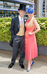 © licensed to London News Pictures. 14/06/2011. Ascot, UK.  Jeremy Kyle and his wife Carla arrive on day one at Royal Ascot races today (14/03/2011). The 5 day showcase event,  one of the highlights of the racing calendar is in it's 300th year. Horse racing has been held at the famous Berkshire course since 1711 and tradition is a hallmark of the meeting. Top hats and tails remain compulsory in parts of the course. Photo credit should read: Ben Cawthra/LNP